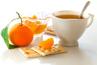 Cup of tea and tangerine