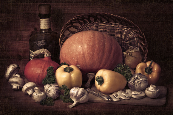 Still life of pumpkins, mushrooms, yellow pepper and parsley on a wooden table